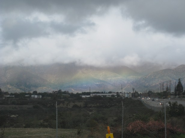 Rainbow over Industrial Foothills by Karen Greenbaum-Maya